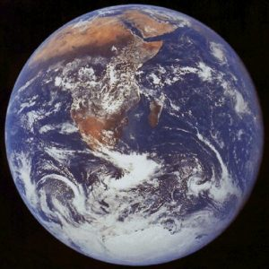 Blue, cloud-covered disk of Earth with Africa showing.